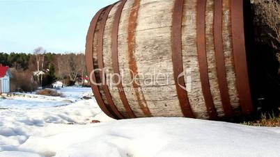 The side view of an old barrel