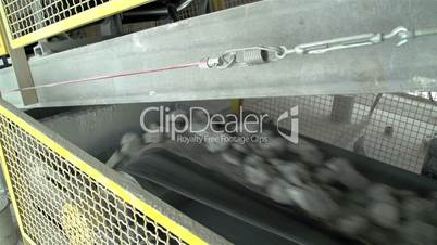 Limestones dropping in a conveyor