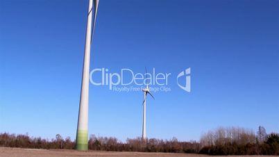 Two windmills on a wide field