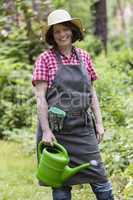 Gärtnerin mit Giesskanne, gardener with watering can