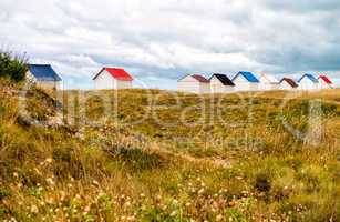 Colorful cabins along the sea. Beach huts along the ocean on a c