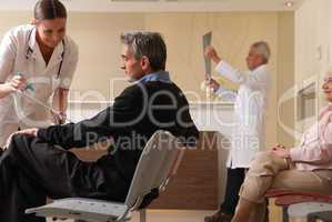 Happy female doctor showing medical results to man in 40s with d