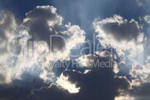 Sun rays through storm clouds