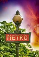 Paris, France. Classic Metro symbol. Subway sign with trees in b