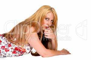 woman lying on floor.