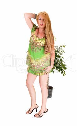 Woman standing in green dress.