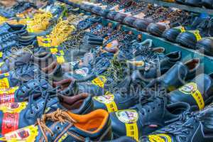 HONG KONG, APRIL 10: Market sale of shoes on the sidewalk road i