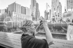 Tourist woman in 70s making pictures to amazing New York skyline