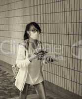 HONG KONG - MAY 12, 2014: Unidentified girl wearing a mask on th