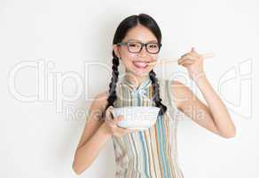 Asian Chinese female eating