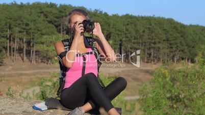 Hiking young woman taking pictures during hike trekking in forest