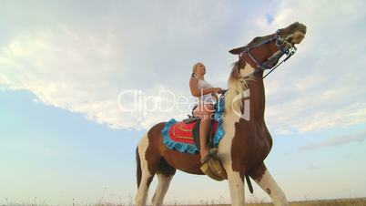 Horseback riding vacations young girl in saddle