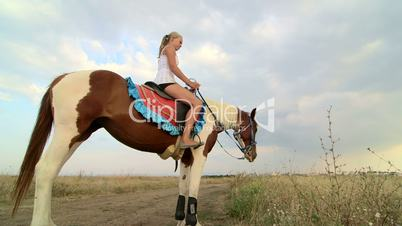 Horseback riding vacations girl rider with her horse