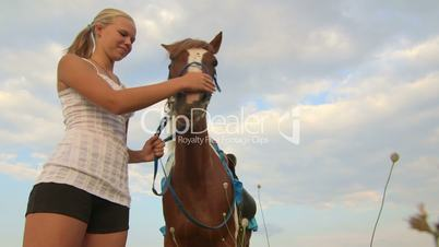 Horseback riding camp vacations girl rider with horse in field