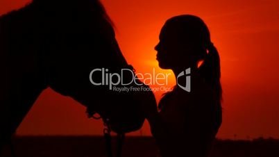 Horseback riding vacations at sunset background