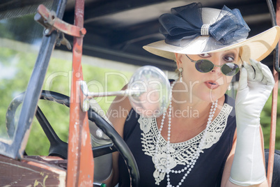 Attractive Woman in Twenties Outfit Checking Makeup in Antique A