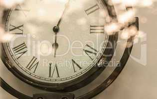 crop steel Vintage analog clock and bright flare reflexing  in s