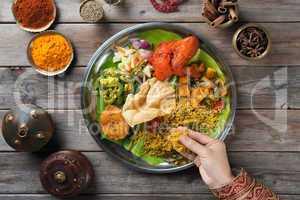 Indian people eating biryani rice