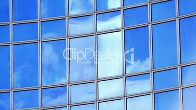 Timelapse of clouds in windows of office building