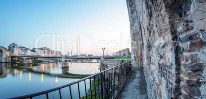 Walls of Pisa along Arno river