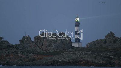 The Creach lighthouse illuminated in evening