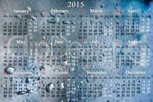 calendar for 2015 year on the surface with drops