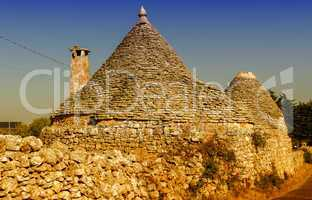 Apulia, Italy. Unique Trulli houses with conical roofs in Albero