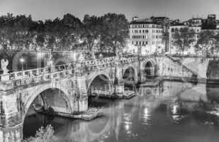 Rome. Lungotevere at night with city bridge
