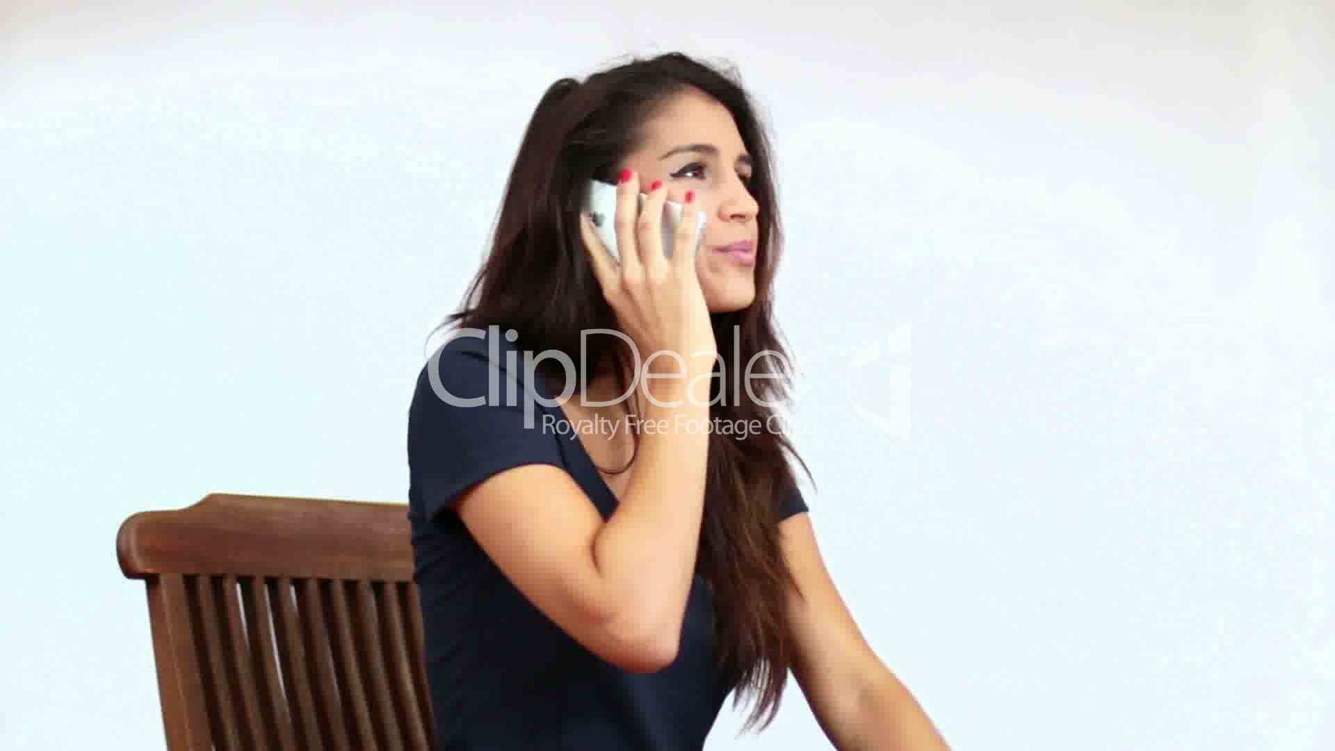 Mediterranean Girl Chatting On The Phone Royalty-Free -5931