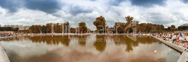 PARIS, FRANCE - MAY 27, 2014: Tourists relax in Bassin Octogonal
