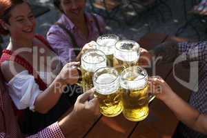 People drinking beer in a traditional Bavarian beer garden