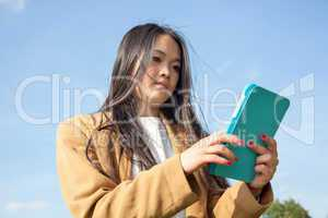 Young woman with mobile tablet PC