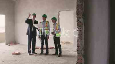 11of23 Manual worker, engineer and architect working in construction site