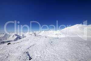 Ski poles on snow slope at nice day