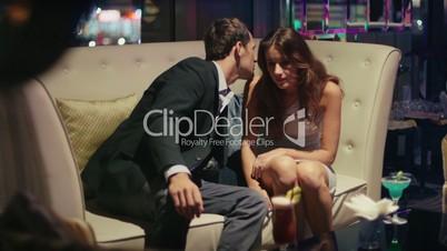 7of7 Young man, woman, girl, having fun in disco, nightclub