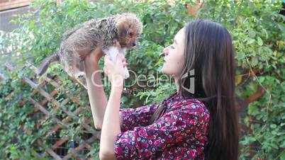 Teenage girl and puppy in the garden
