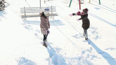 Girls having fun in snow