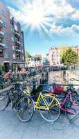 Amsterdam. Colourful yellow and pink Bicycles over the Canal