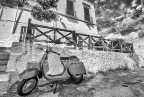 POLIGNANO AL MARE, ITALY - AUG 28: Blue vintage Vespa in old str