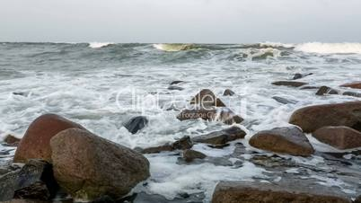 Waves and foam on rocky beach Indian Ocean