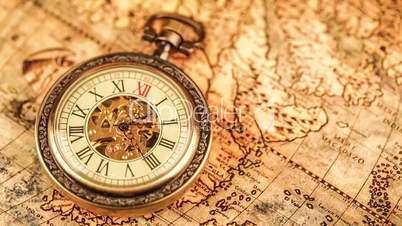 Vintage antique pocket watch on the background of old books vdeos vintage antique pocket watch on ancient world map in 1565 gumiabroncs Gallery