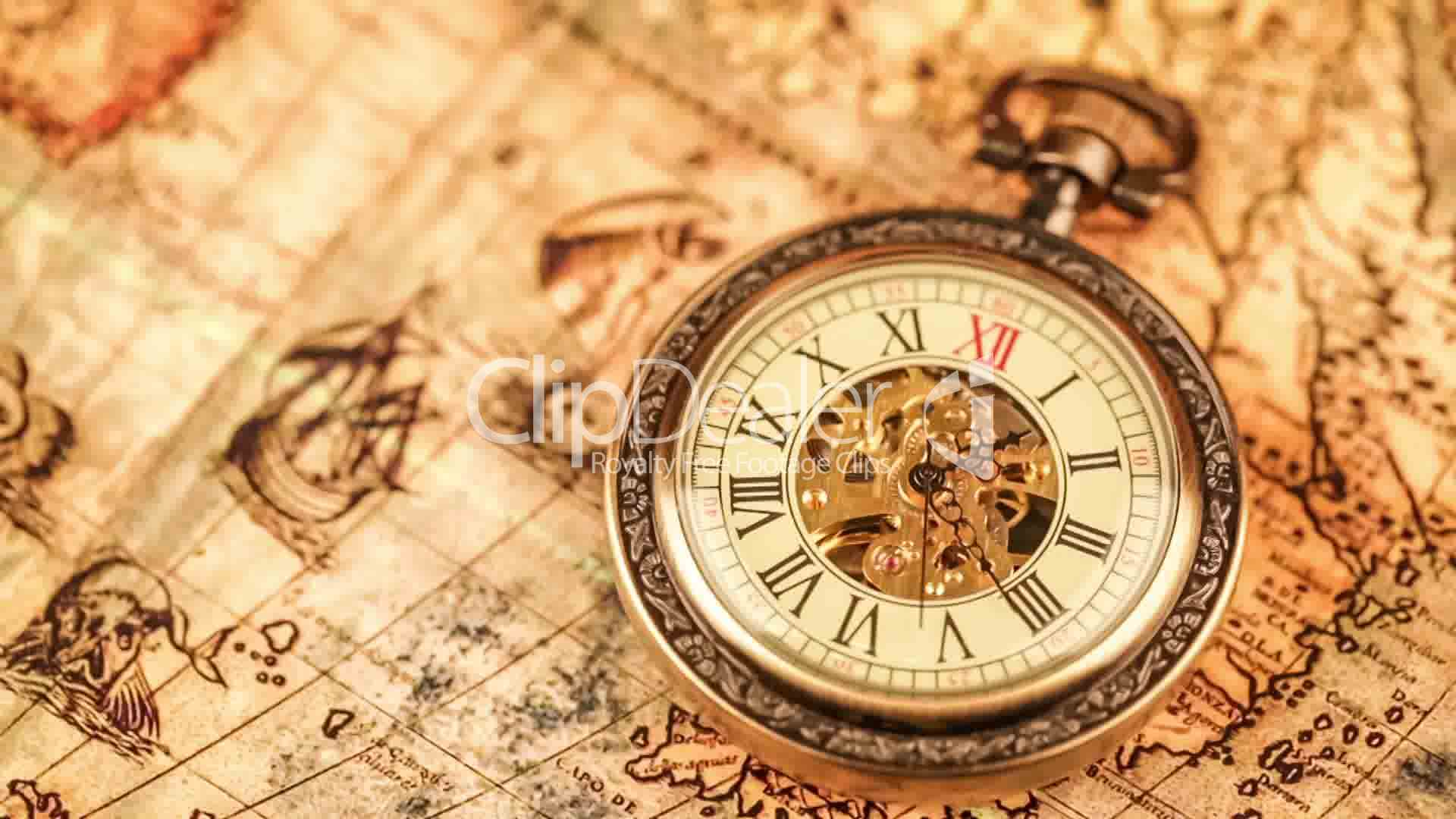 Vintage antique pocket watch on ancient world map in 1565 vdeos clips gumiabroncs Gallery