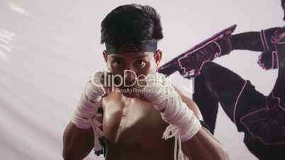 10of20 Asian man, fighter training, kickboxing in gym, combat sport