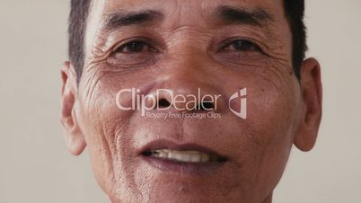 Portrait of real Asian people, with emotions and feelings, looking at camera, seniors. Serious old man from Cambodia, Asia. Closeup of face, 54of56