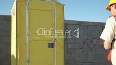 Male Construction Worker Portable Bathroom Close