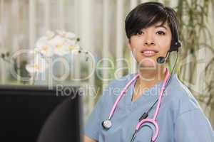 Mixed Race Female Nurse Practitioner or Doctor at Computer