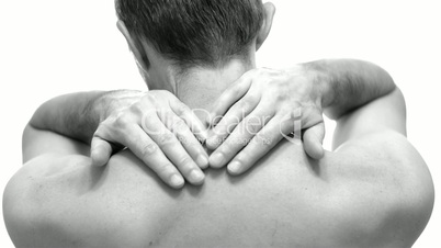 Male Rubs Neck To Relieve Pain