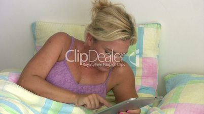 Beautiful woman with digital tablet receiving good news