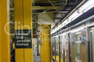 New York - Queens subway station with train stopping