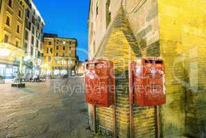 BOLOGNA, ITALY - OCTOBER 9, 2014: Red mail boxes outside a post